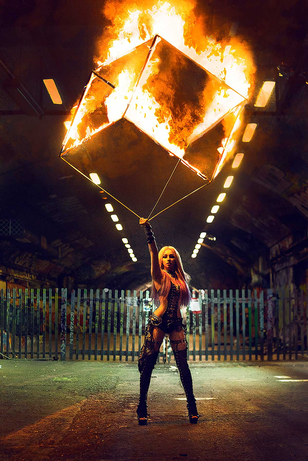 Gem Dee performing her flaming cube act.