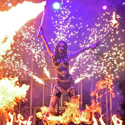 Shelly d'Inferno performing her dragon canes act.