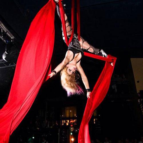 Gem Dee performing an aerial silk act.