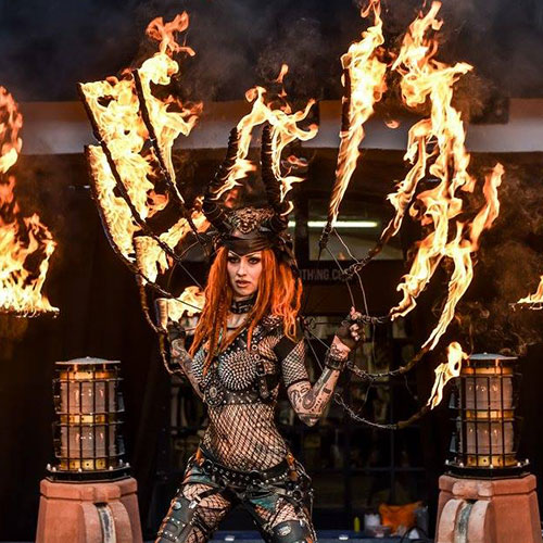 Shelly d'Inferno performing her burning wings act.